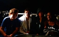 Four teens after their night dive with Sail Caribbean Divers