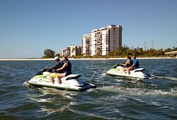 Our friends and us enjoying a beautiful day at Fort Myers Beach with our guide Zach