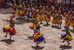 Bhutan festival Tours.Mask dance during the festival in Bhutan