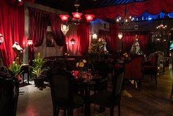 VELVET is dark, sensual and mysterious, sparking with creativity and smoldering passion. Inside you'll find deep red, plush decor, ceilings adorned with chandeliers, glimmering original art and pulsing after hours music - matched by devilishly good cocktails and fresh, unique food.