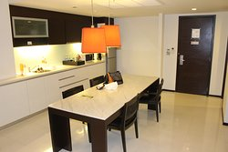 Two Bedroom Suites feature a large kitchen with a large table seating four.