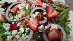 Oscar's Harvest Salad with Strawberries, Pecans and bleu cheese. May order with Grilled Chicken or our Rasberry Vinaigrette dressing