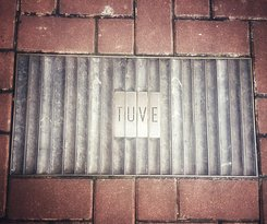 The Subtle TUVE sign in the pavement