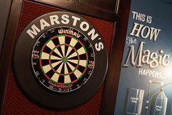 Enjoy a game of darts at the new look Gardeners Arms