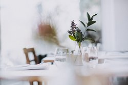 We always use locally sourced, seasonal English flowers and greenery on our tables.