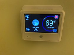 Room control unit with weather information