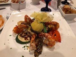 Grilled Shrimp served over grilled veggies.
