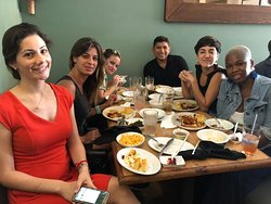 Tour guests enjoying a soul food lunch in Overtown.