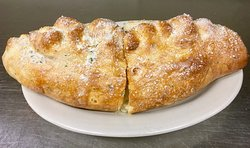 Our calzones are made from scratch when you order. They take 25-30 minutes to make but are worth the wait!