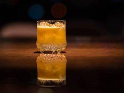 Utopian! En fruktig frisk drink baserad på bland annat Brännland Iscider, Daishichi Umeshu och Apelsin.