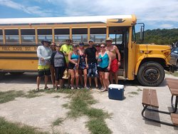 Camp Tomahawk Two-Mile Tube Float, tubing and camping group photo with shuttle service