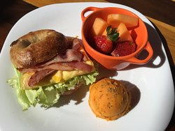 Formosa Breakfast Bagel  serve with bacon, egg, veggie, sweet potato and seasonal fruits