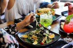 Grilled Shrimp & Asparagus Salad   gulf shrimp, asparagus, mixed greens, grape tomato, shaved romano cheese, chopped egg, fig & cane-syrup vinaigrette