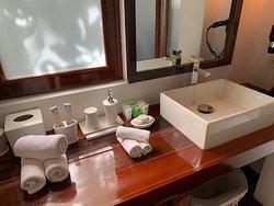 Bathroom amenities by sink/vanity in Naked Island villa