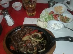 Sizzling hot steak fajitas assorted toppings
