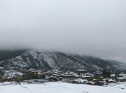 First snow fall in bhutan and the view of Thimphu dzong covered with blanket of snow.