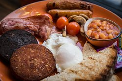 BóTOWN BREKKIE - pork & veg sausages, smoked streaky bacon, poached or fried eggs, mushrooms. black & white pudding, chargrilled cherry tomatoes and toasted sourdough served with tea/coffee