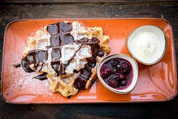 WAFFLES served with chocolate sauce, berry compote and ice cream