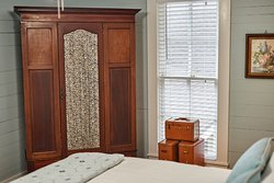 Morning Glory room with Queen bed.  Room does not have private bath at this time.
