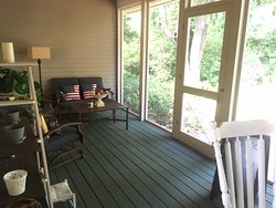 Screened porch common area for guests to enjoy.