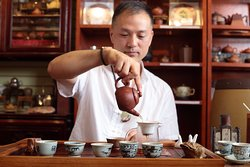 Making tea with traditional Gong Fu Cha style.
