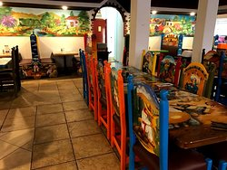 Colourful booths and paintings.