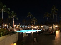 View of the main pool at night. There is a restaurant and bar just to the right.