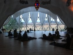 Preparing for a class in the Om Dome