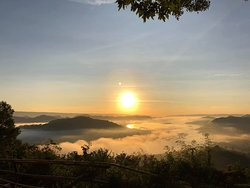 good morning sun over sea of fog