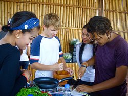 Our awesome guides teaching khmer cuisine tricks