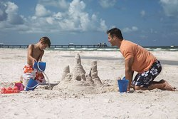 Father and Son Building Sandcastle