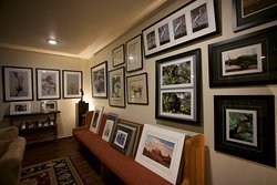 """Second view of main room with additional view of the low tide trilogy on the far wall, the set includes 3 - 15 x 27"""" four color prints of seaweed on the beach at low tide."""