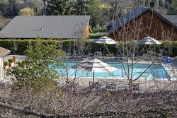 Overview of the heated pool.  there is also a hot tub next to it on the left of this photo