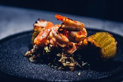 ARGENTINIAN SHRIMPS Marinated in a homemade spice mix and served on a bed of our herbed rice with Pineapple three ways.