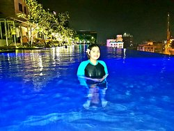 My daughter in the infinity pool at night.