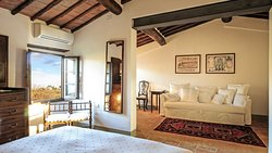 """""""Giò Suite"""": large double bed, square terracotta floor dating back to the eighteenth century, wooden beamed ceiling and nineteenth century pieces of furniture in typical country style..."""