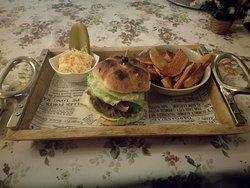Bison Burger with grilled onion, tomato, grilled zucchini, served with chips and cabbage salad and pickles