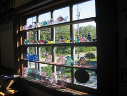 Studio window full of vases and other products