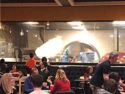 Viewing window allows you to watch the chefs tossing pizza dough.