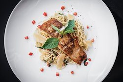 Grilled snapper with angel hair pasta and parmesan shaving.