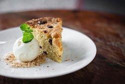 Homemade coconut and raisin cake, served with vanilla ice-cream.