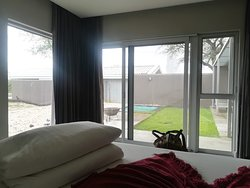 View of the lawn and lounge from the bedroom in the luxury room