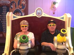 For all ages. Mom and Dad on Toy Story Mania at Hollywood Studios. Walt Disney World