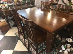 High top table with 4 chairs.