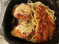 Carryout: Chicken Parmigiana (2 fried parmesan-breaded chicken breasts, homemade marinara sauce, melted Italian cheeses) with spaghetti