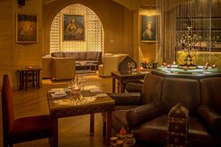 comfortable seating and remarkable interior design add tranquility to our Moghul Room
