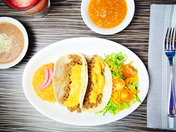 Lunch Special   #2   two chicken or beef tacos Tex-Mex; served with red rice and beans