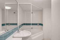 adina serviced apartments canberra james court two bedroom apartment master bathroom