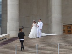 the wedding couple coming down the stairs