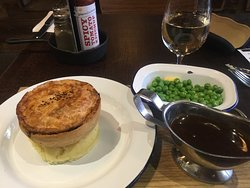 Kevin pie with mash and garden peas, served with gravy.
